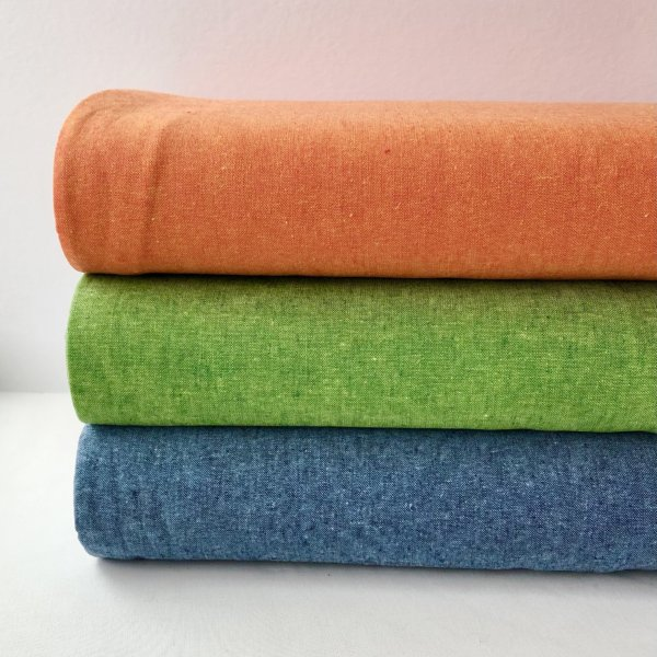 Flame orange Essex Linen, stacked with Palm Green and Nautical Blue Essex Linen