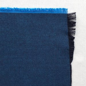 Rich blue fabric swatch, showing black warp and cyan weft