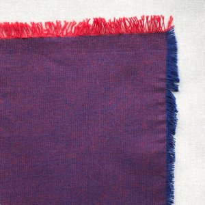 Grapey purple fabric swatch, showing deep davy warp and bright red weft