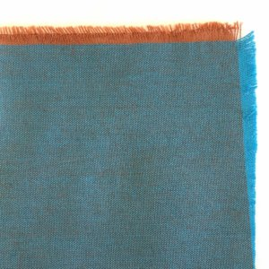 Rich brown fabric swatch, showing bright cyan warp and coppery weft
