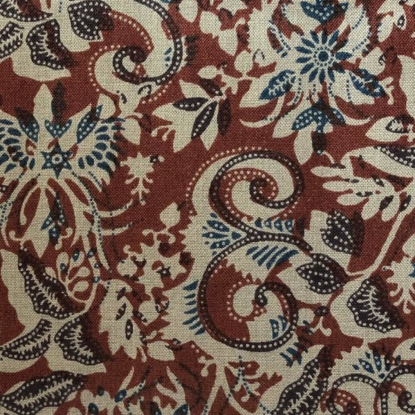Rust and blue botanical chintz printed on light taupe cotton.