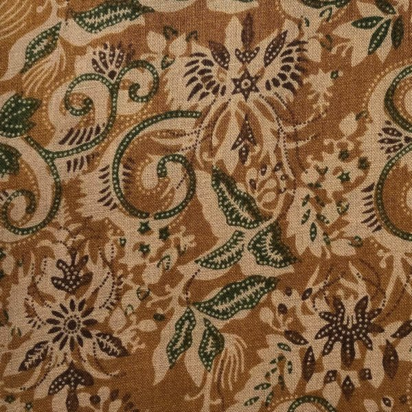 Gold and green botanical chintz printed on beige cotton.