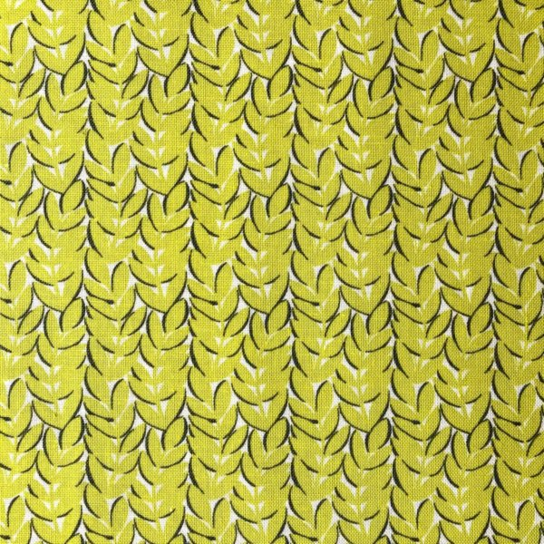 Chartreuse fabric with dense, abstractly leafy print