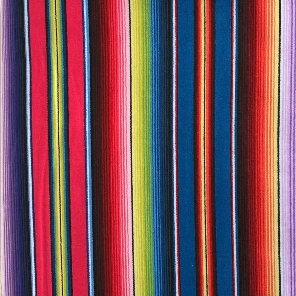 Bright and multicolored striped fabric, printed to look like a Mexican serape