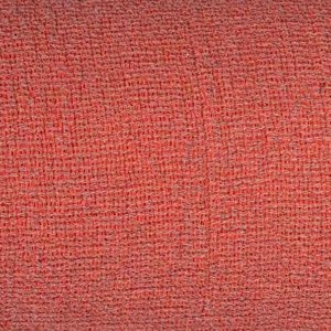 Macro close up of red fabric showing its gauze-like weave structure. Also clear in the extreme close up are the gray weft and deep coral warp combined to create the illusion of solid red color.