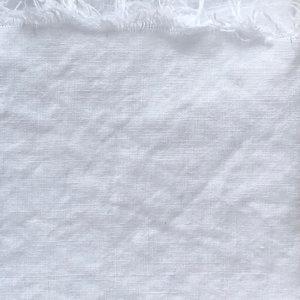 Close up of plain, undyed fabric.