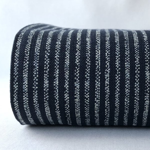 Indigo homespun with all-over print of evenly spaced stripes