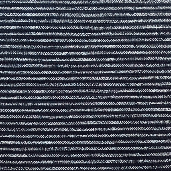 Close up of indigo homespun fabric printed with evenly spaced white stripes