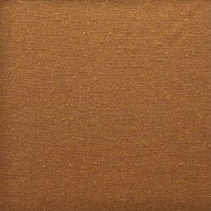 Close up of rich golden caramel, slightly nubby silk fabric