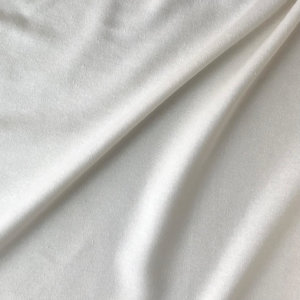 Close up of natural off-white, slightly nubby silk fabric