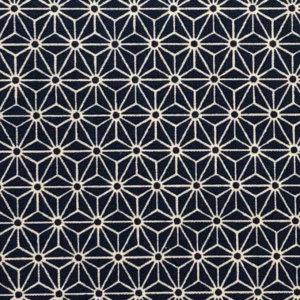 Deep indigo fabric with white, 1-inch interlocking asanoha (hemp leaf) motif