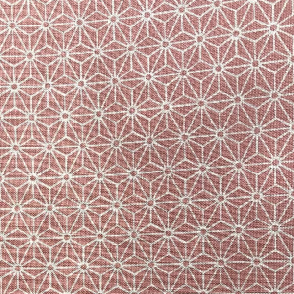 Cherry blossom pink fabric with white, 1-inch interlocking asanoha (hemp leaf) motif