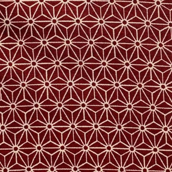 Rich red fabric with white, 1-inch interlocking asanoha (hemp leaf) motif