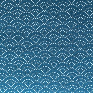 Teal fabric with white dotted scalloped waves.