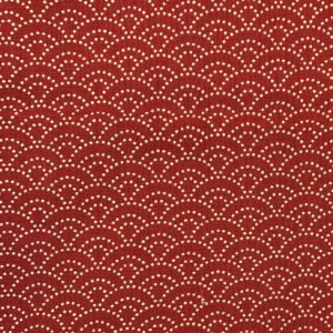 Red fabric with white dotted scalloped waves.