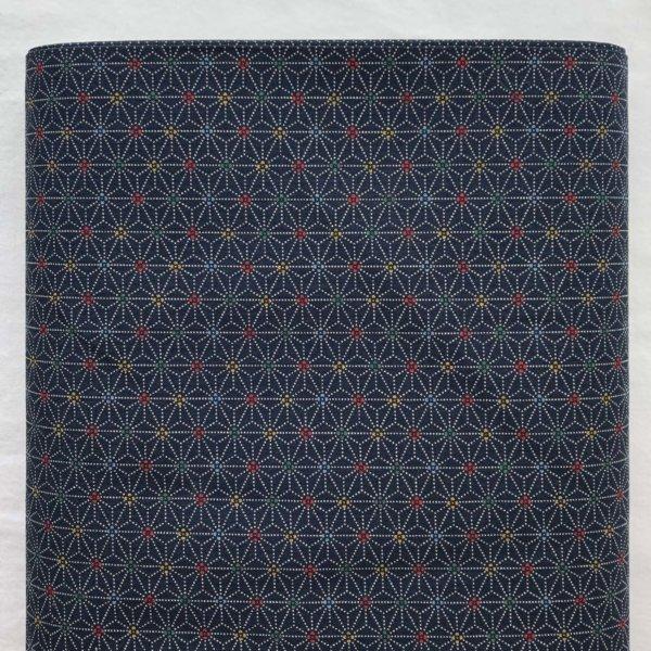 Deep indigo fabric with dotted white, 1-inch interlocking asanoha (hemp leaf) motif and tiny, multi-colored centers