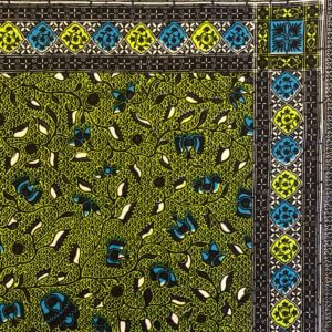 Close up of the corner of green and blue botanical print panel, bordered with green and blue rosettes