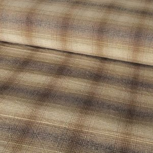 Beige and buff plaid with a hind of cream.