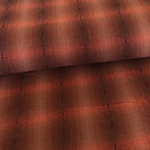 Salmon-y brown and pinkish plaid shot trough with black