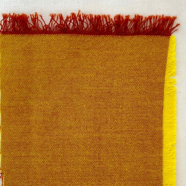 Orange fabric swatch, showing bright yellow warp and coppery weft