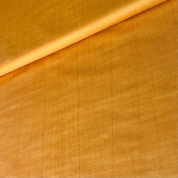 Rich golden silk fabric
