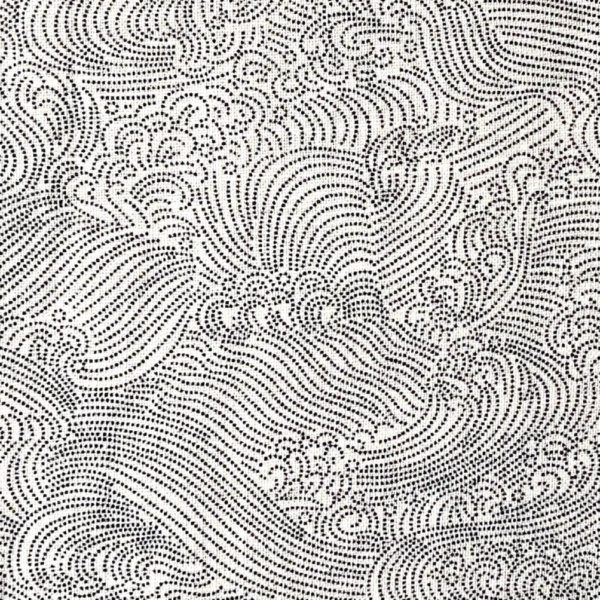 Close up of white homespun fabric printed with a blue pattern of delicate, swirling waves