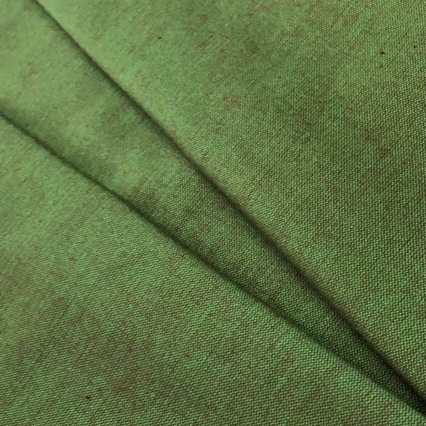 Earthy, forest green fabric, pleated.