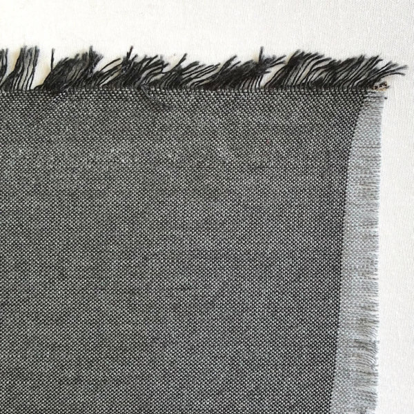 Fabric detail showing a bright silvery gray warp and ash gray weft.