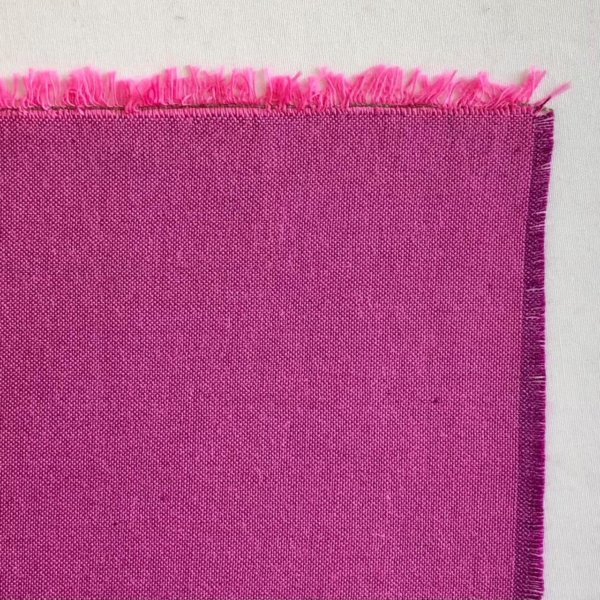Fabric detail showing a dark mulberry purple warp and Barbi pink weft.