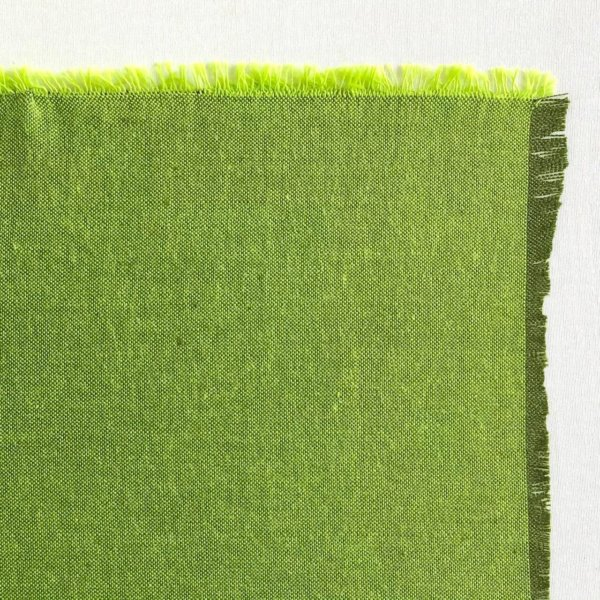 Fabric detail showing a dark pine green warp and bright, almost neon green weft.