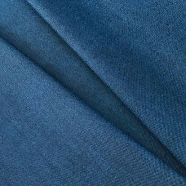 Dark blue fabric, pleated.