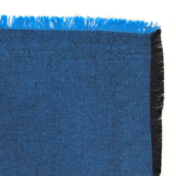 Fabric detail showing a black warp warp and bright blue weft.