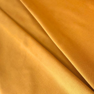 Golden curry colored fabric, pleated.