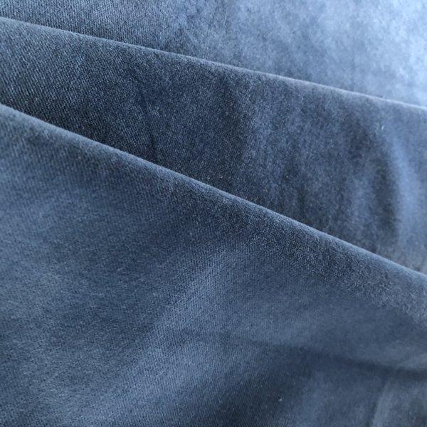 Light blue velveteen. That's it. Nothing else in the photo.