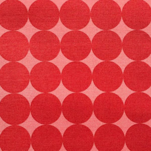 Deep red circular shapes, touching edges in perfect rows and columns, on a light orange background.