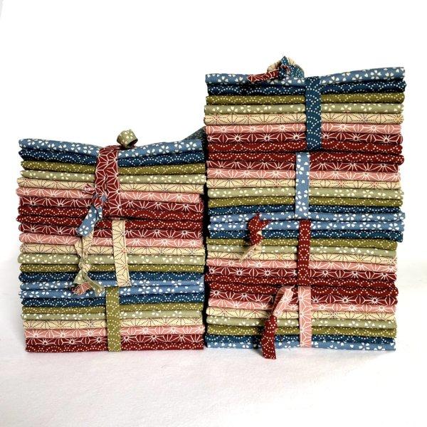 multiple bundles of brightly colored japanese fabrics.