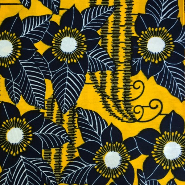 Golden fabric with black clematis-like print