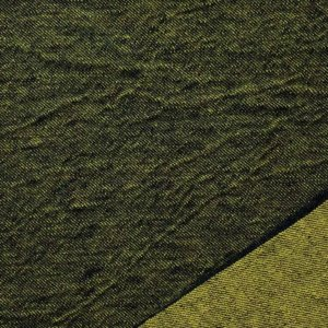 Dark green twill with lower corner folded over to show light green back side of fabric