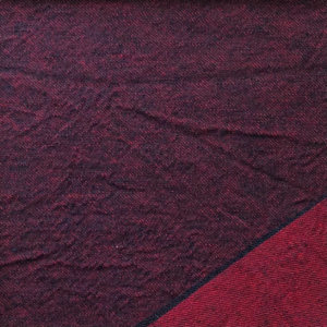 Dark purple twill with lower corner folded over to show the red back side of fabric