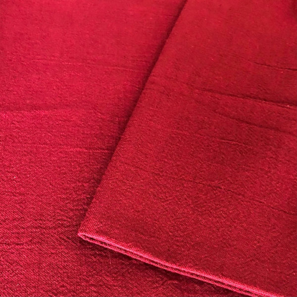 dep red fabric with a subtle surface texture