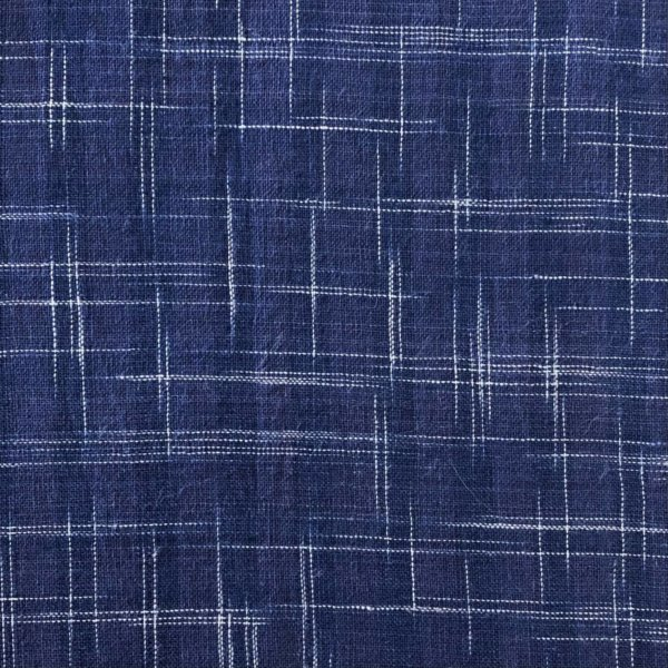 Handwoven Indigo blue fabric with ikat crosshatching
