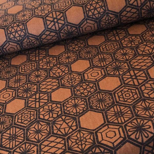 Brown fabric with black hexagonal print.