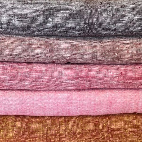 Stack of five different colors of matka fabric.
