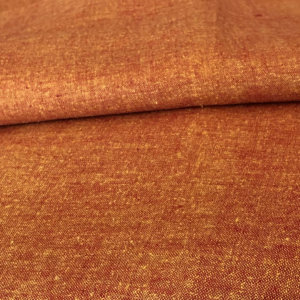 Fiery orange fabric, with silken luster.