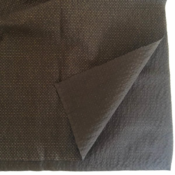 """Closeup of brown seersucker-like fabric with subtle tan printed """"stitches"""""""