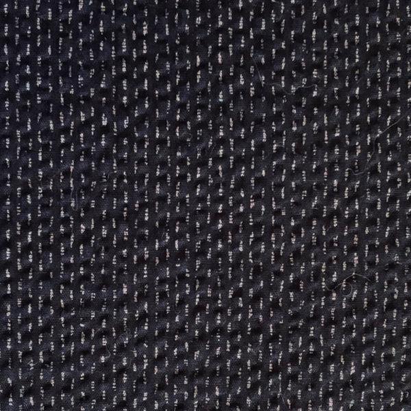 Rippling indigo blue seersucker with subtle lighter blue parallel stitch print
