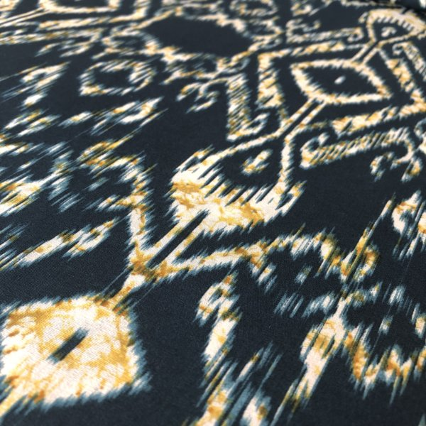 Turquoise, highly detailed ikat print with cream and yellow accent.