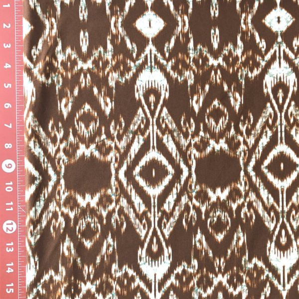 Brown umber, highly detailed ikat print with cream and pine green accent.