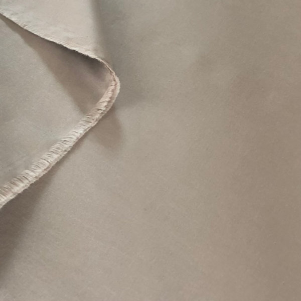 Soft beige solid fabric