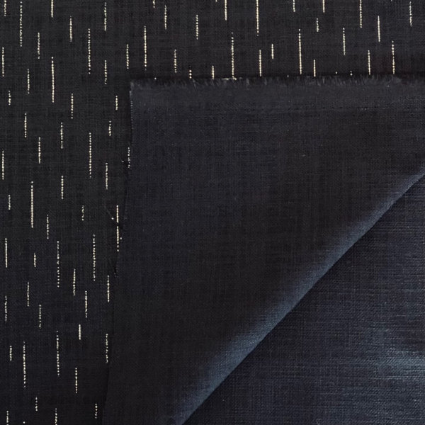 Dark indigo blue fabric with intermittent thin, white marks, like soft rain on a windless night
